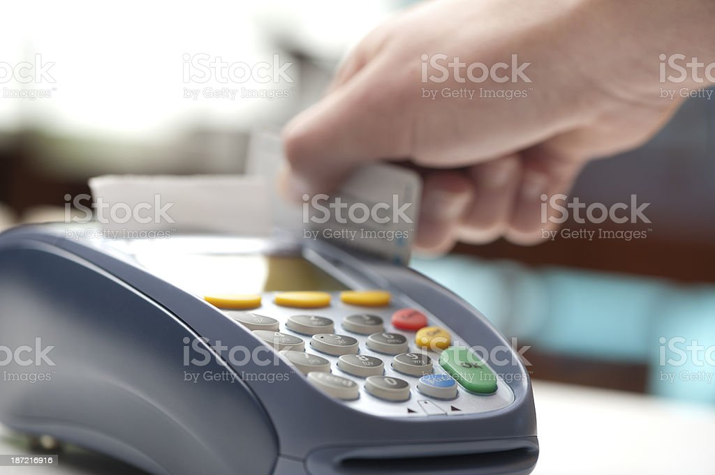 Swiping card on an eftpos machine in retail store stock photo