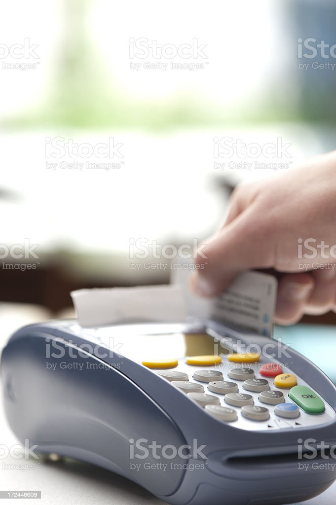 Swiping card on an epfpos machine in retail store. stock photo
