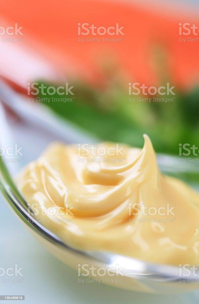 Swirl of creamy sauce on a spoon royalty-free stock photo