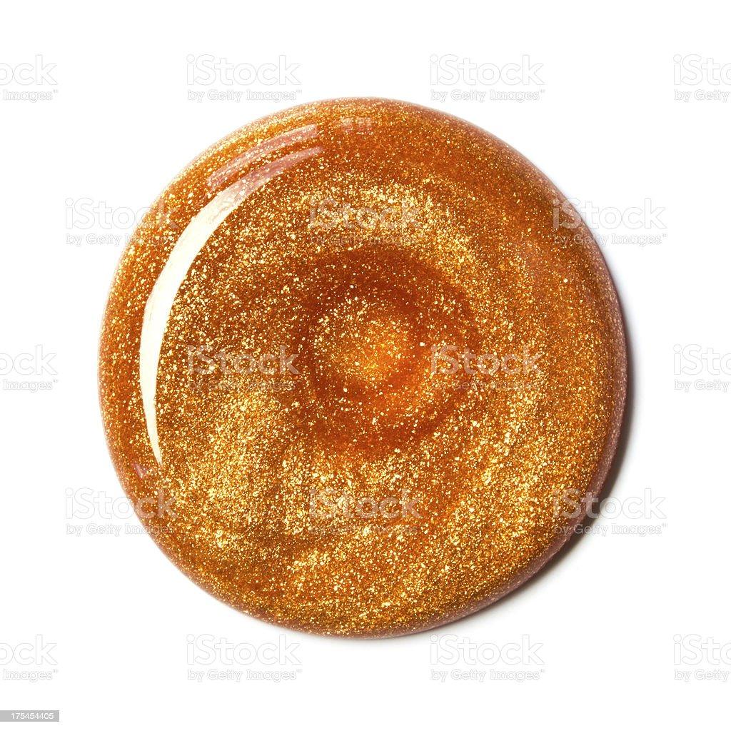 Swirl of orange nail polish, overhead view stock photo