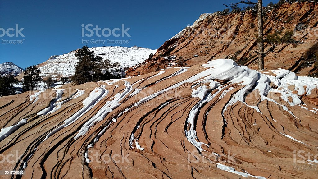 Swirling and layered red rocks in winter Zion Canyon Utah stock photo