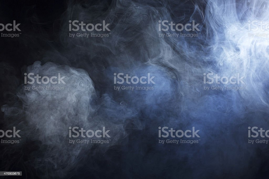 Swirling Grey and blue smoke stock photo
