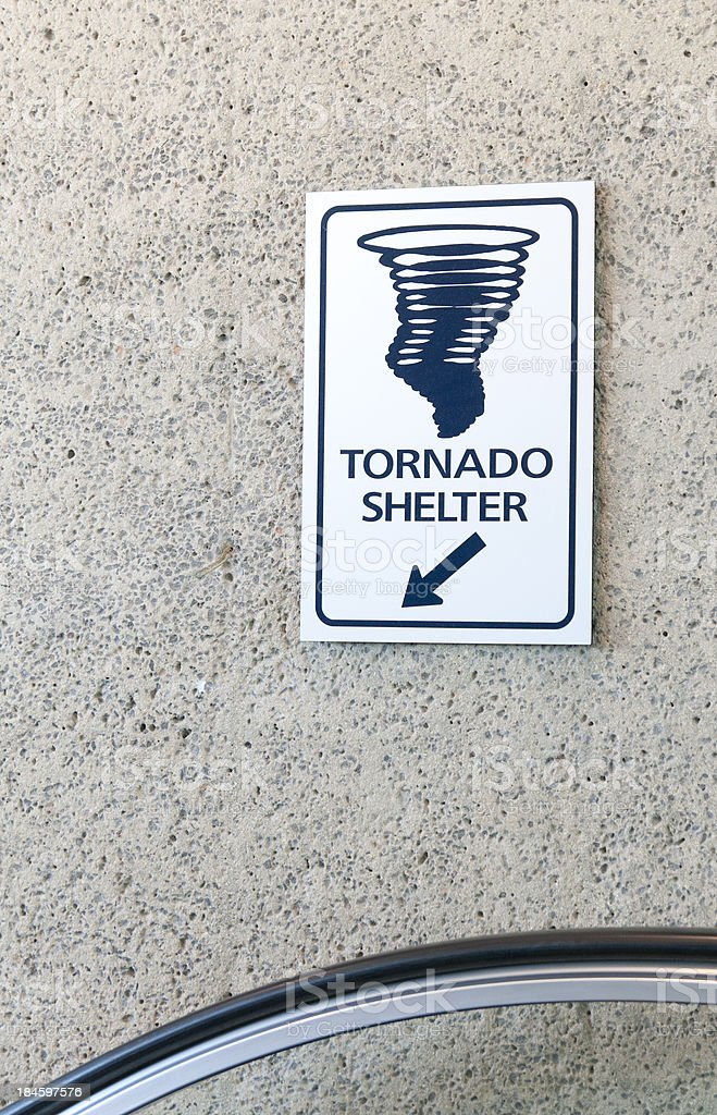 Swirling Tornado Sign Indicates Shelter Location stock photo
