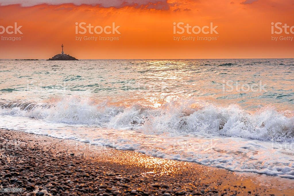 Swirling waves at sunset in Greece stock photo