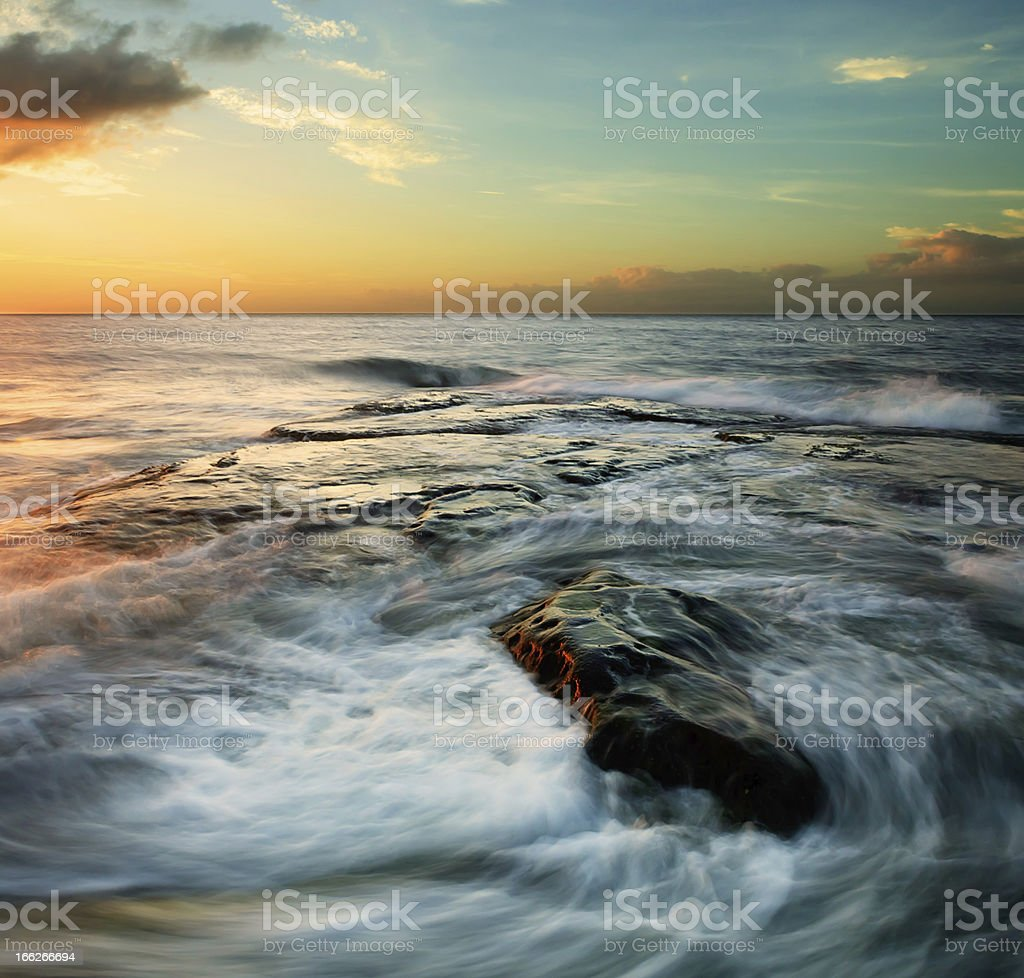 Swirling waves at sunset royalty-free stock photo