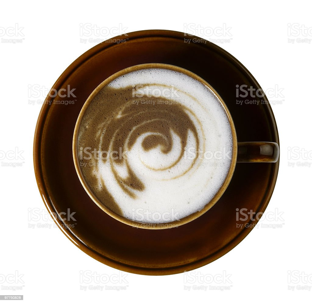 swirly milk froth in a cup of coffee stock photo
