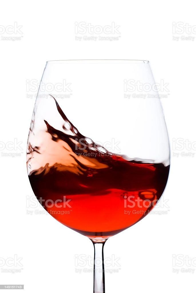 A swishing glass of red wine on a white background royalty-free stock photo