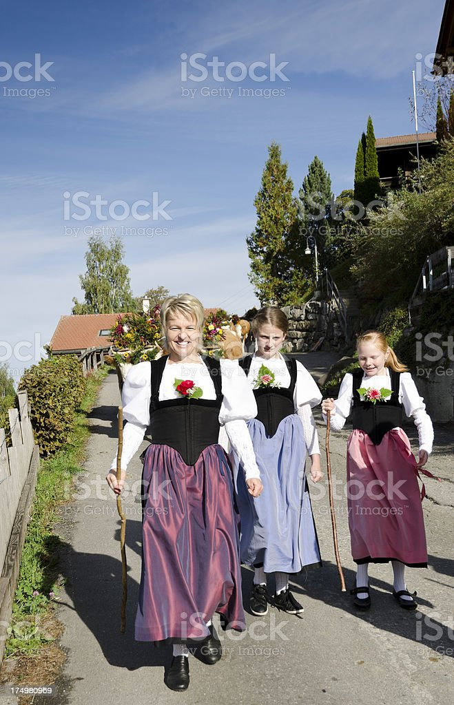 Swiss Alpine farmer family bringing the cattle to town royalty-free stock photo
