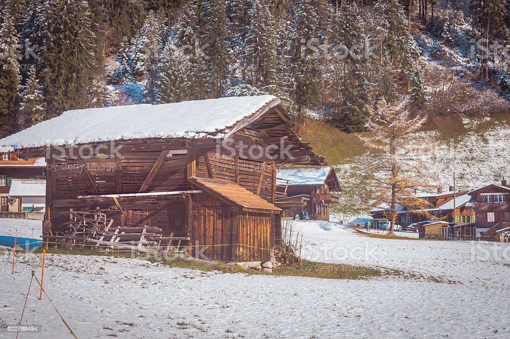 Swiss Alpine landscape, Obersimmental, with wooden barn stock photo