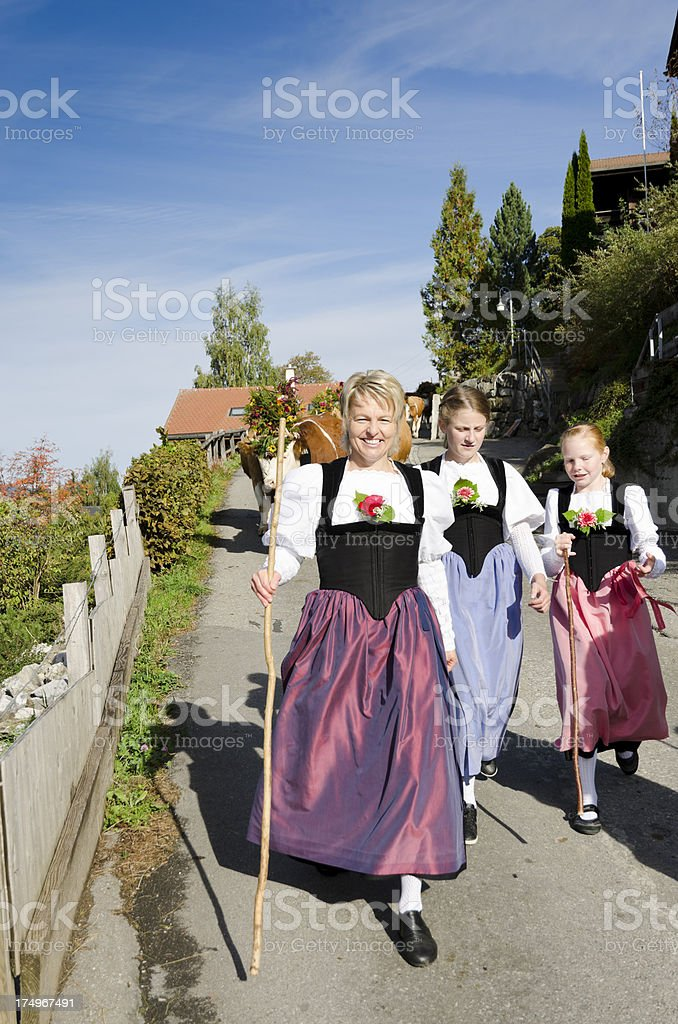 Swiss Alpine mother with daughters in traditional dress stock photo