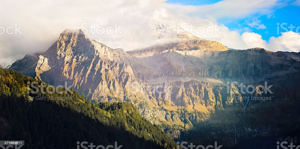 Swiss Alps: Breaking the Clouds stock photo