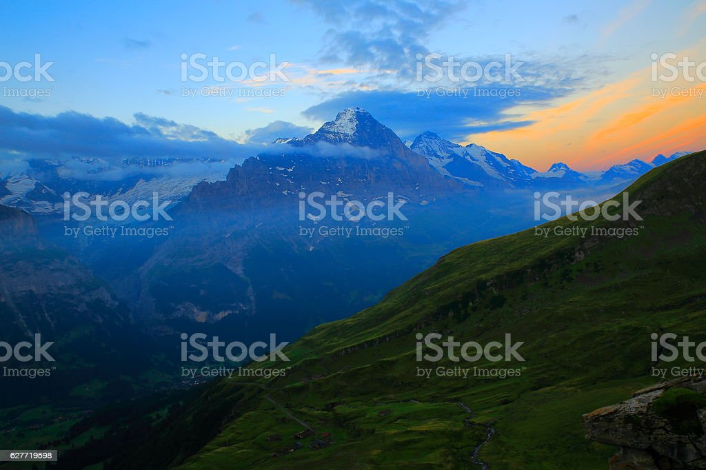 Swiss Alps: Eiger, river stream above Grindelwald valley, dramatic dawn stock photo