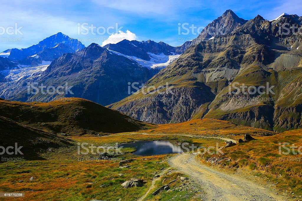 Swiss alps, lake reflection, country road, alpine meadow, Zermatt stock photo