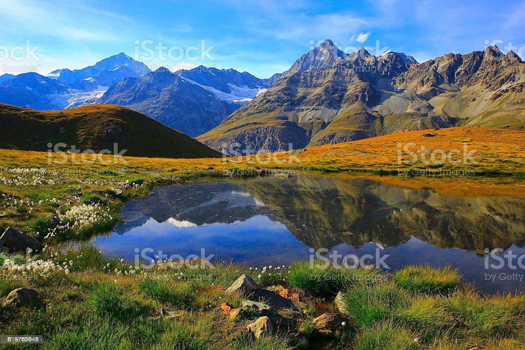 Swiss alps, lake reflection, golden autumn alpine meadow, Zermatt stock photo
