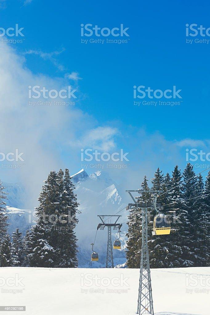 swiss alps landscape with gondolas stock photo