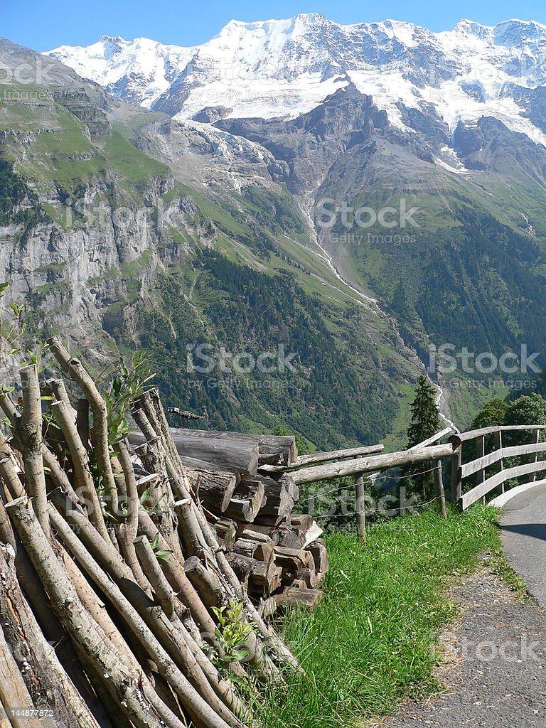 Swiss Alps Log pile royalty-free stock photo