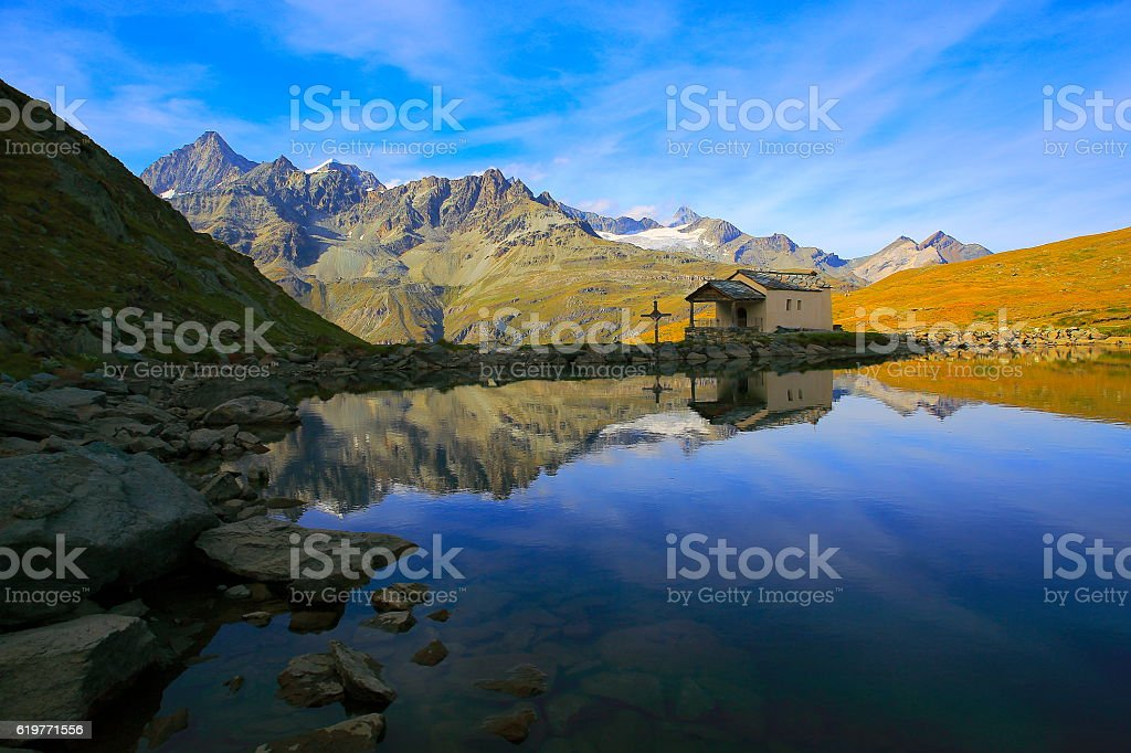 Swiss alps, Schwarzsee lake reflection, Chapel in alpine meadows, Zermatt stock photo