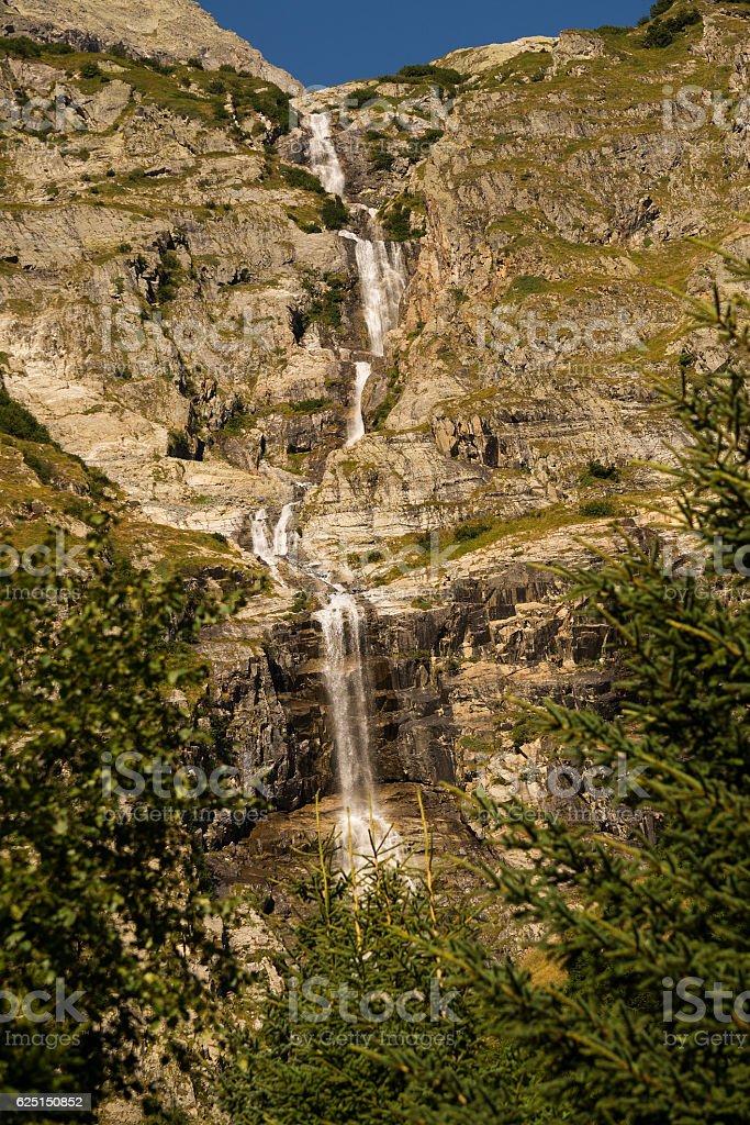 Swiss alps waterfall stock photo