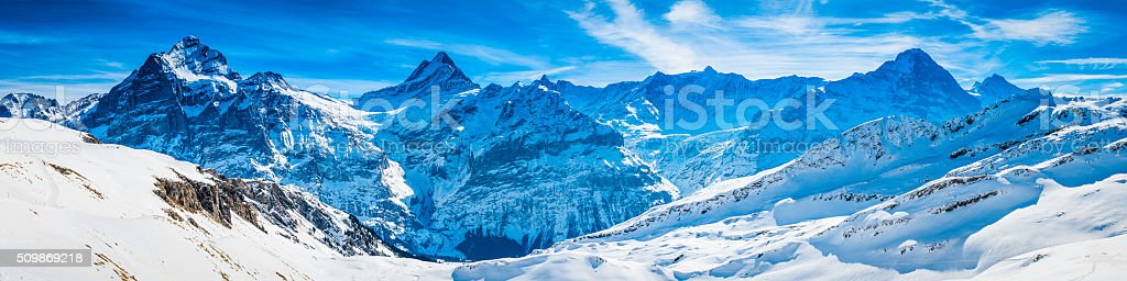 Swiss Alps winter moutain peaks panorama Wetterhorn Schreckhorn Eiger Jungfrau stock photo