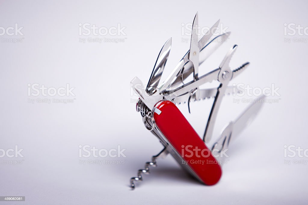 Swiss Army knife against white background stock photo