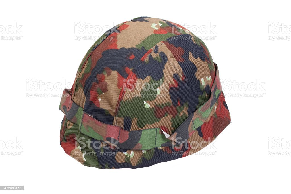 swiss army stell helmet with camouflaged cover stock photo