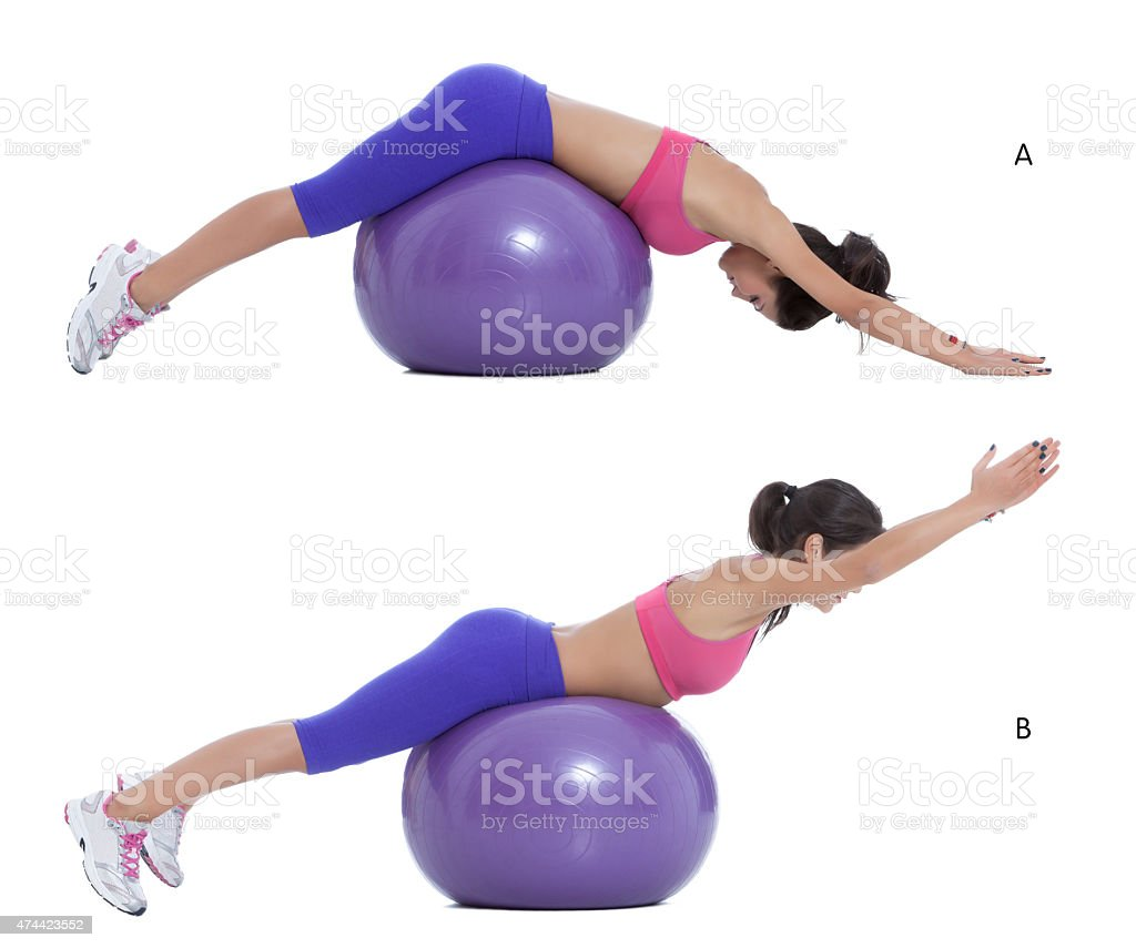 Swiss ball back extension stock photo