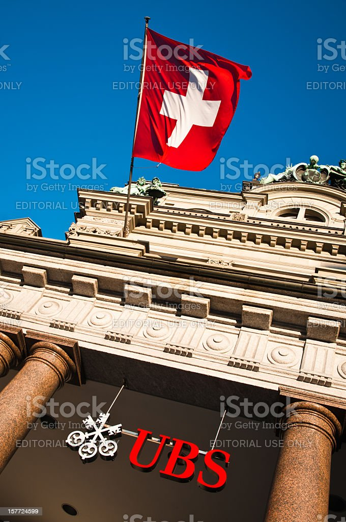 Swiss bank UBS building with waving flag of Switzerland stock photo