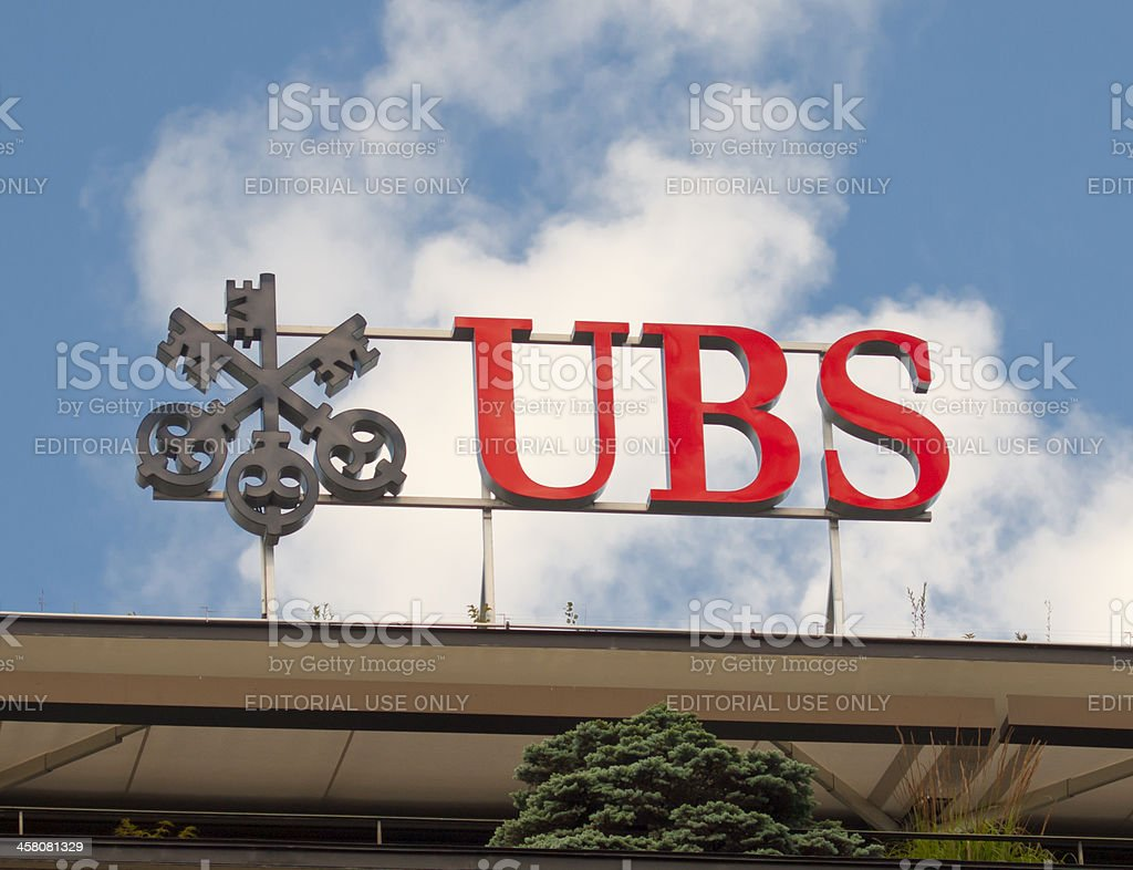 Swiss bank UBS logo on Zurich headquarters building rooftop stock photo