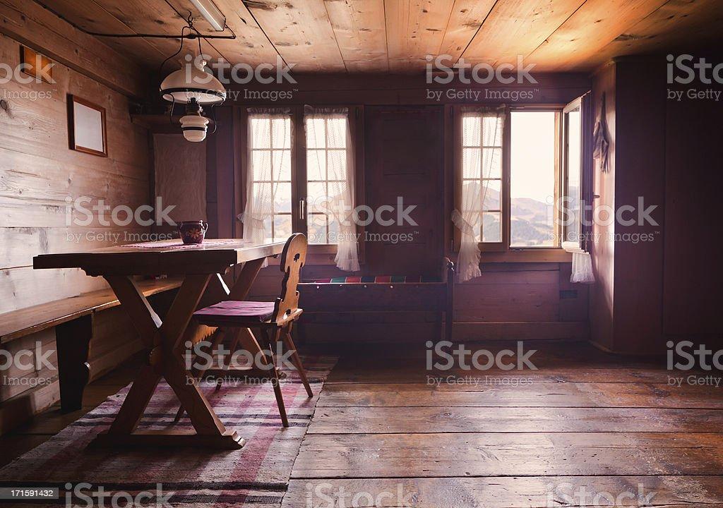 Swiss cabin dining room interior back lit stock photo