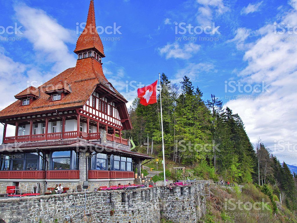 Swiss chalet in mountains stock photo