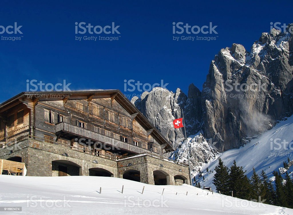 Swiss Chalet in winter royalty-free stock photo