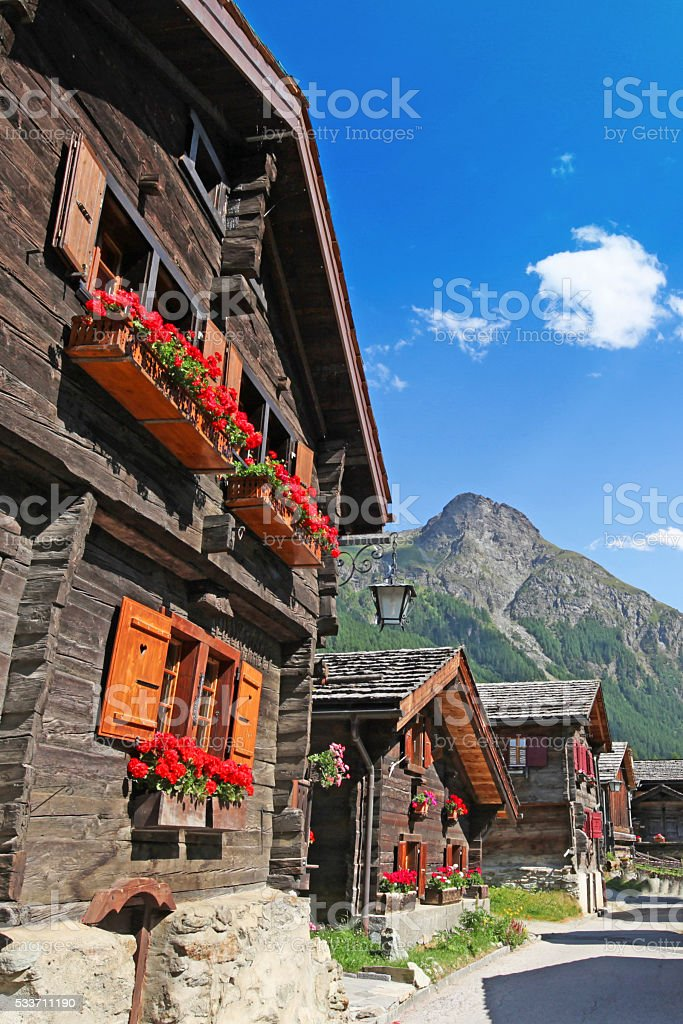 Swiss Chalets in the Mountains in Summer stock photo