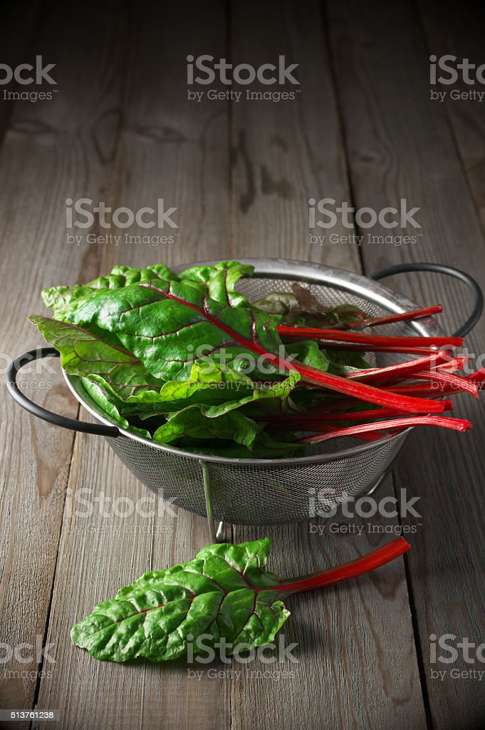 Swiss chard in colander stock photo