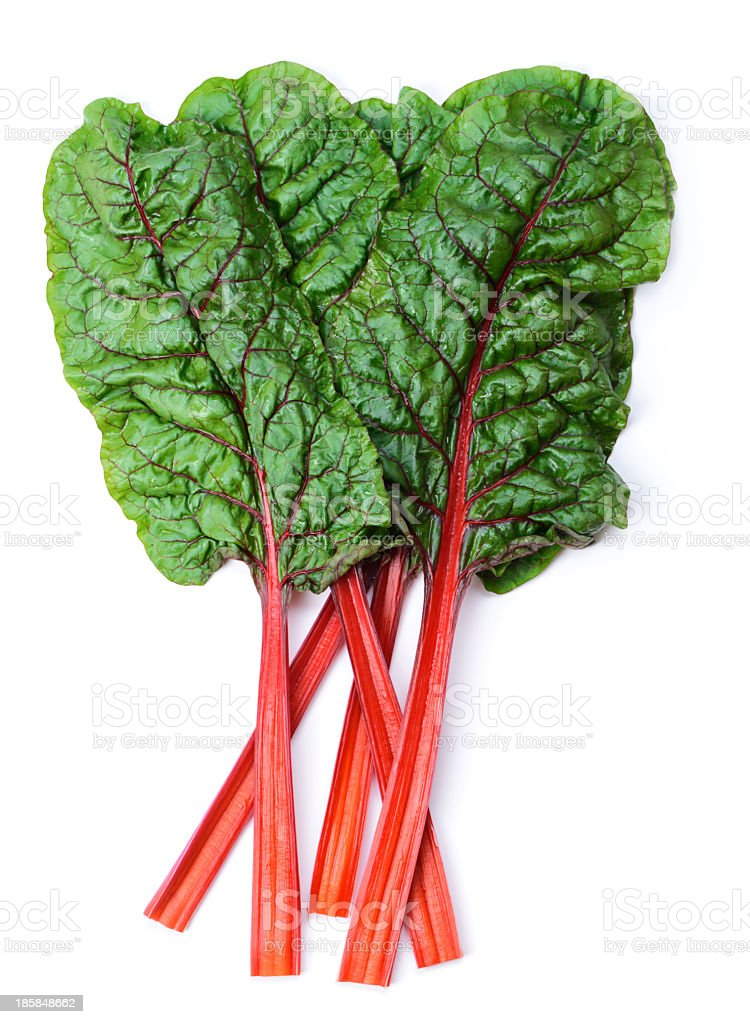Swiss chard laid on white surface stock photo
