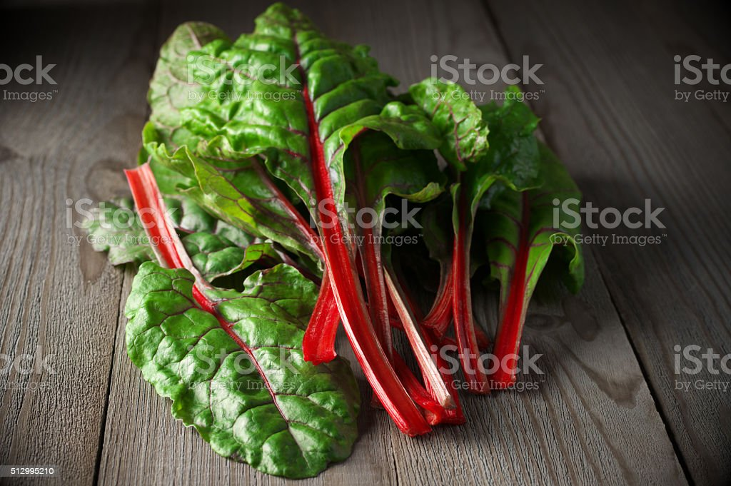 Swiss chard on wood stock photo