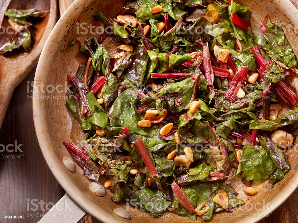 Swiss Chard Saut?ed with Garlic,Olive Oil and Pine Nuts stock photo