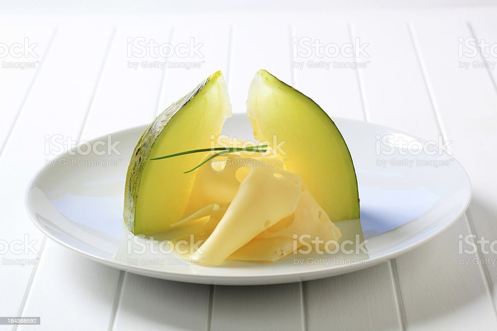 Swiss cheese and melon royalty-free stock photo