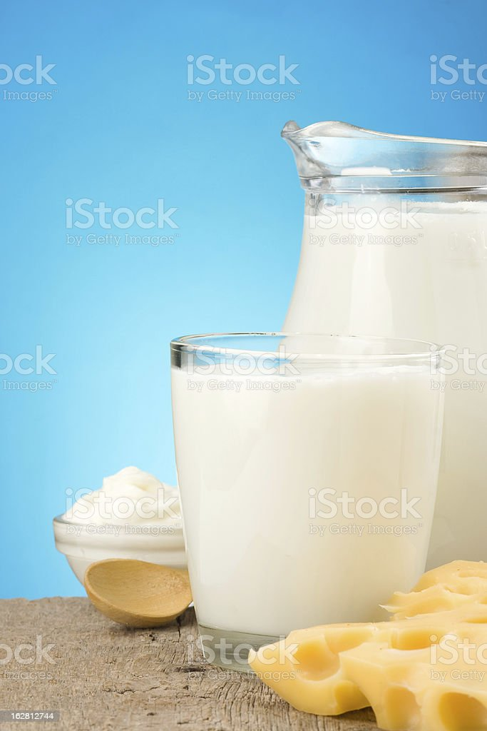 swiss cheese and milk products on wood background royalty-free stock photo