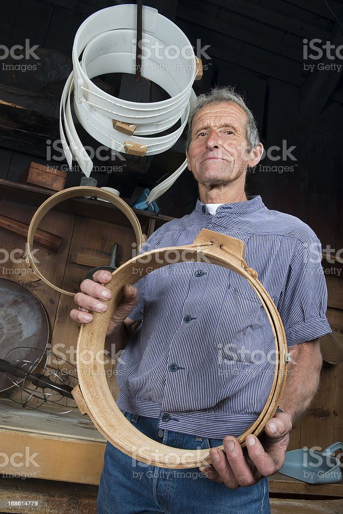 Swiss Cheese Maker Stands with Empty Mould stock photo