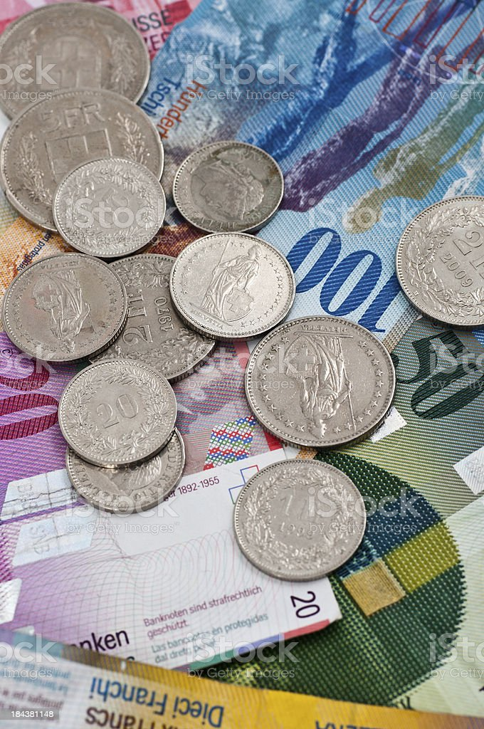 swiss coins and notes stock photo