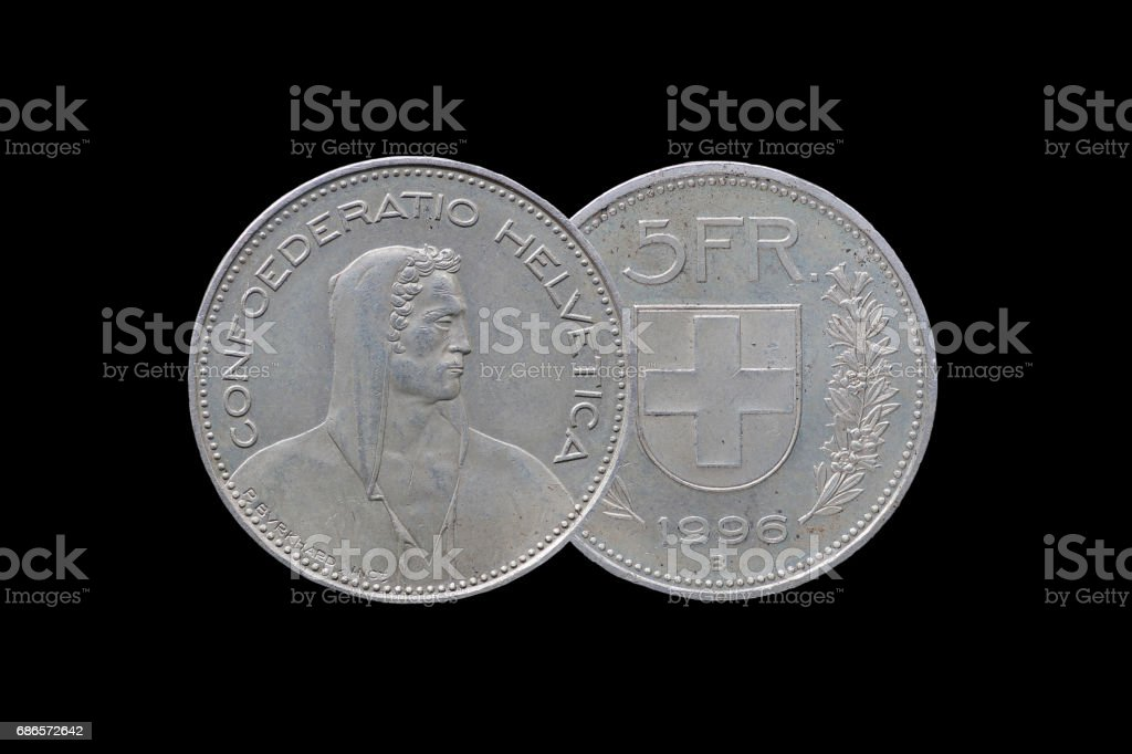 Swiss Confederation money coin 5 Francs isolated on black background, 1996 year. stock photo