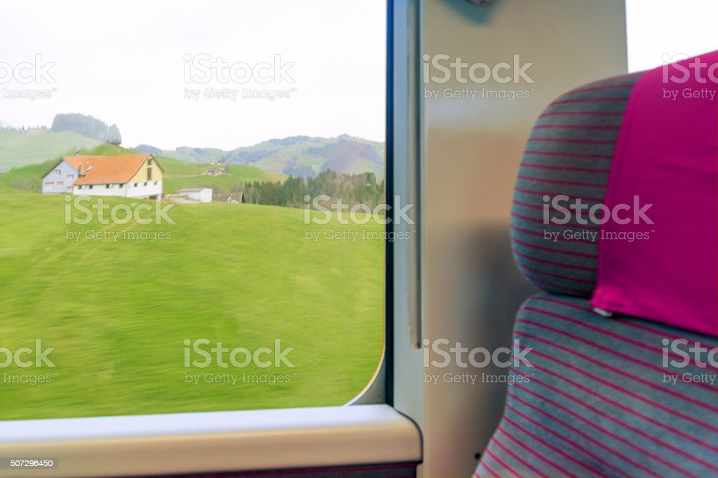 Swiss countryside landscape view from a train stock photo