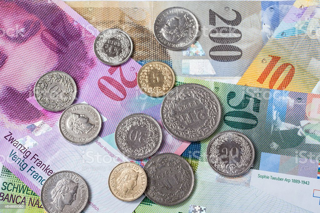 Swiss currency banknotes and coins stock photo