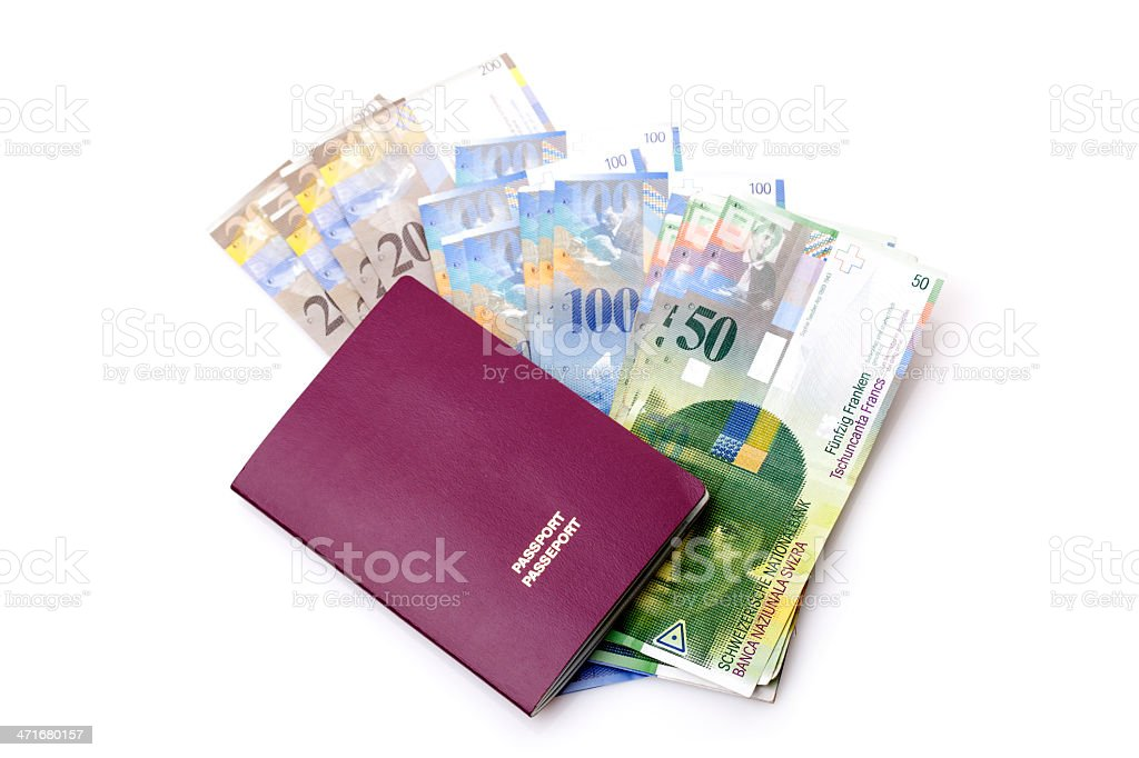 Swiss currency francs and passport royalty-free stock photo
