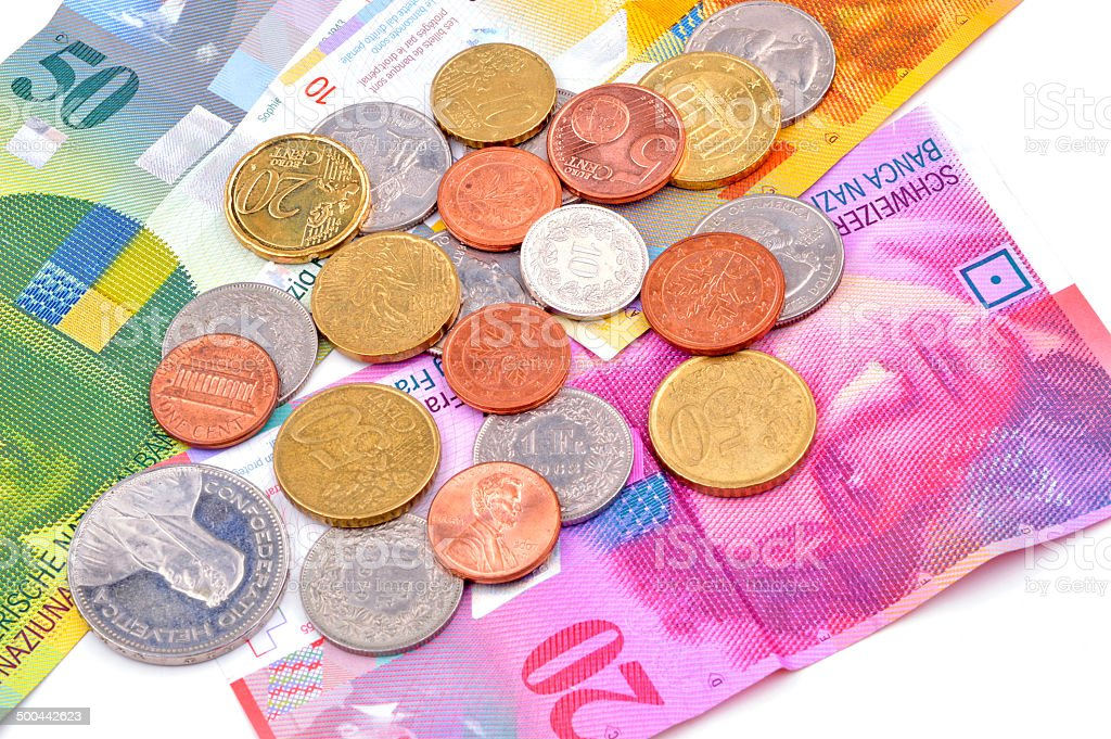 swiss currency francs on white background stock photo