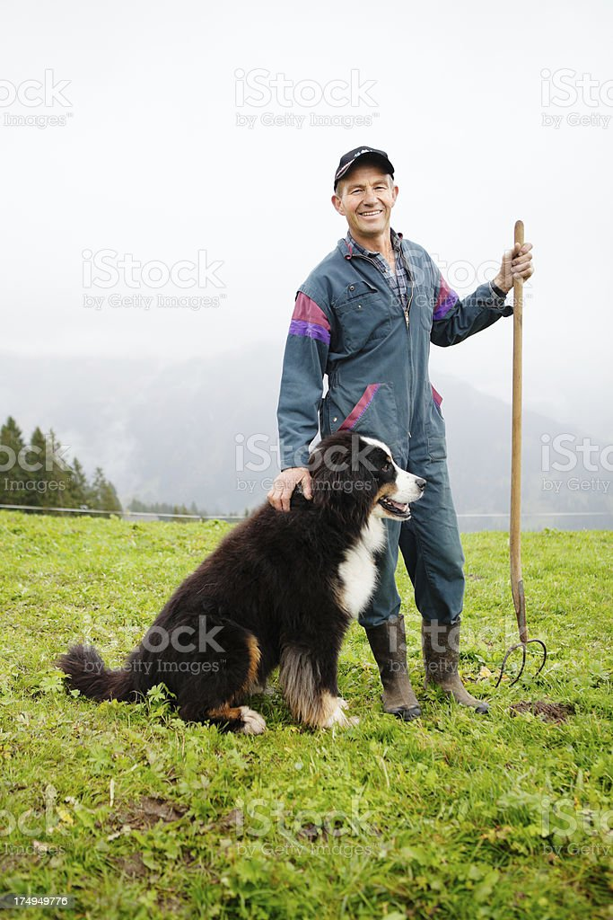 Swiss Farmer and his Dog royalty-free stock photo