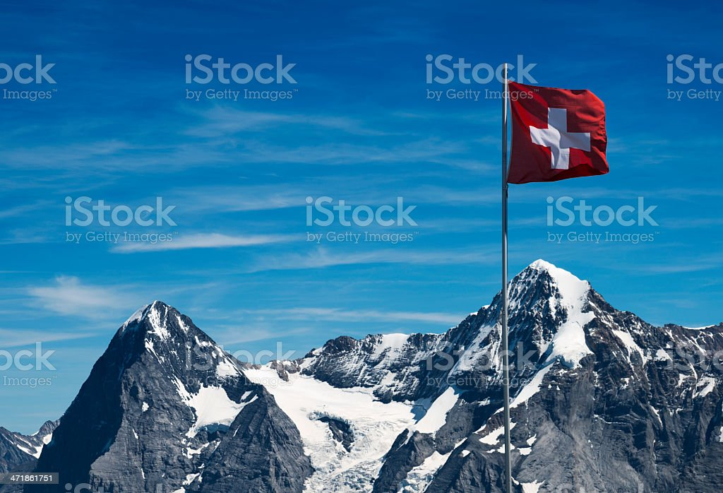 swiss flag and european alps stock photo