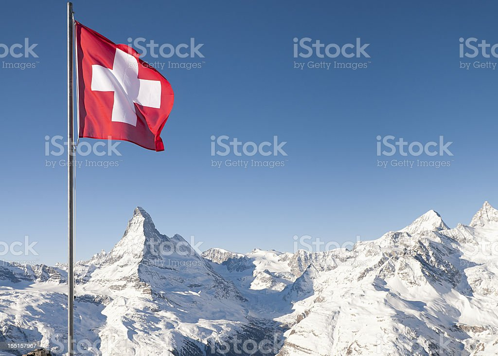 Swiss Flag and the Matterhorn stock photo