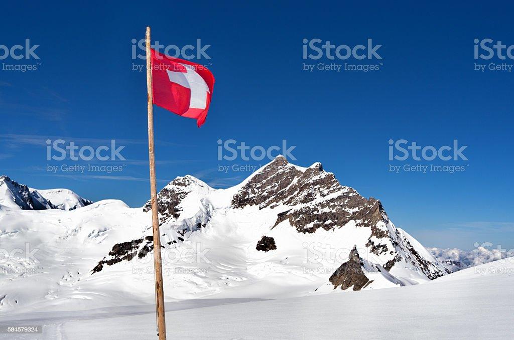 Swiss flag at the Jungfrau, Switzerland. stock photo