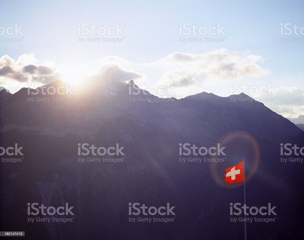 Swiss flag catching sun. stock photo